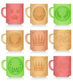 Set of multi-colored mugs with patterns Royalty Free Stock Photo
