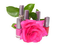 Set of multi-colored nail polish with flower roses Stock Photography