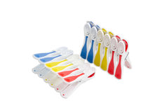 Set of multi-colored plastic clothespins on a light background Stock Photo