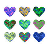 A set of 9 multi-colored polygonal hearts. Vector illustration on isolated background Stock Image