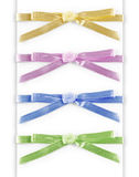 Set of multi-colored satin ribbon with a bow isolated on white Stock Images
