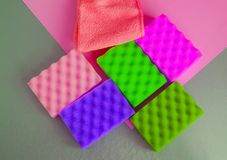 A set of multi-colored sponges and rags for cleaning and cleanliness on a gray background, the concept of outsourcing. Cleaning company, top View, flat lay stock photo