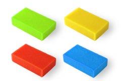 Set of multi-colored squire bath sponge. Orange squire bath sponge isolated on white Stock Photos
