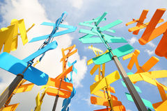 Set of multi-colored vanes and signs on background of blue sky Stock Images