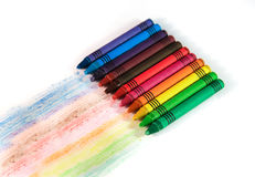 Set of multi-colored wax crayons with drawing stripes on a white Stock Photo