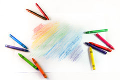 Set of multi-colored wax crayons with drawing stripes on a white Stock Images