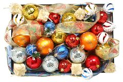 Set of multi-coloured celebratory ornaments and ribbons. In a box Royalty Free Stock Image