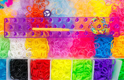 Set of multicolored bands, hook tool and loom Stock Photos