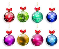 Set of multicolored Christmas balls with red bows. Set of multicolored Christmas balls with and without snowflakes and with red bows Royalty Free Stock Photo