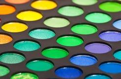 Set of multicolored eyeshadows Stock Photos