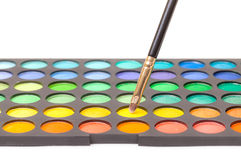 Set of Multicolored Eyeshadows with Brush Royalty Free Stock Photos
