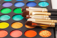 Set of Multicolored Eyeshadows with Brushes Stock Photo