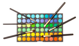 Set of Multicolored Eyeshadows with Brushes Royalty Free Stock Photo