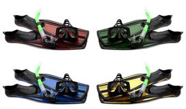 Set of multicolored flippers, mask and snorkel with water drops Stock Photography