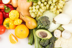 Set of multicolored fresh raw vegetables and fruits,. On white Stock Photos