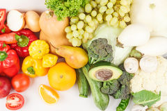 Set of multicolored fresh raw vegetables and fruits,. On white Royalty Free Stock Image