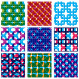 Set of multicolored grate seamless patterns with parallel ribbon. S and geometric figures, transparent symmetric bright wavy tiles, infinite geometric surface Royalty Free Stock Photos