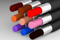 Set of multicolored lipsticks on the light background. Set of saturated multicolored lipsticks on the light background Stock Image