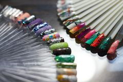 Set of multicolored nail in the Cabinet of nail technicians. Pro royalty free stock images