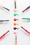 Set of multicolored nail polish brushes and drops Royalty Free Stock Photos