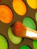 Set of Multicolored orange-yellow Eyeshadows with Brush, closeup stock photo