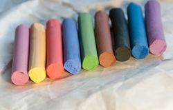 Set of multicolored pastel pencils on a light background. Selective focus. Royalty Free Stock Photography