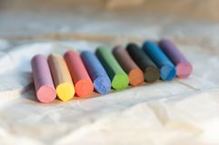 Set of multicolored pastel pencils on a light background. Selective focus. Stock Photos