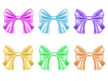 Set of multicolored satin bows. Set of colored shiny bows stock illustration
