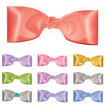Set of multicolored satin bows on white background Stock Images