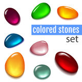 Set of multicolored stones. Isolated colored stones on a white background. Red stone. Yellow stone. Blue Stone. Pink stone. Purple stone. Green stone. Stones Stock Photography