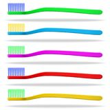Set of multicolored toothbrushes. White background . Isolated objects. Vector image Stock Images