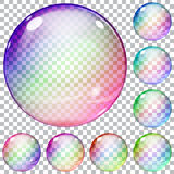 Set of multicolored transparent glass spheres. On a plaid background Royalty Free Stock Images