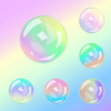 Set of multicolored transparent glass spheres on a plaid background Stock Photos