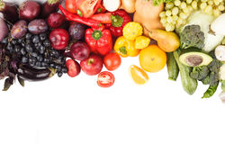 Set of multicolored vegetables and fruits, isolated. Set of multicolored fresh raw vegetables and fruits, isolated Stock Photo