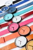 Set of multicolored wristwatches. On white background Stock Photography