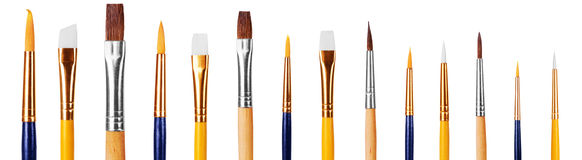 Set of multiple used and new drawing brushes isolated over the w Royalty Free Stock Photo