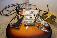 Set of music objects on electric guitar Royalty Free Stock Photos