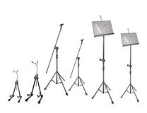 A Set of Music Stand, Microphone Stand and Guitar  Stock Photos
