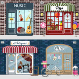 Set of music, toys, antiques and gift shops. Gramophone and sewing maching in the antique shop window. Bike with gift boxes in basket and birdcage with roses at Stock Photo