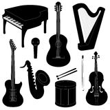 Set of musical instruments silhouettes. Isolated on white Royalty Free Stock Image