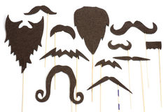 Set of mustache and beard silhouettes for party. Funny disguise for party – beard and mustache silhouettes Stock Photography