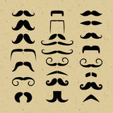 Set mustache silhouettes on a retro background Stock Images