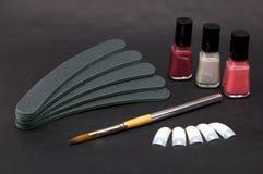 Set of nail care accessories. Minimalistic set of nail care accessories on dark background stock photo