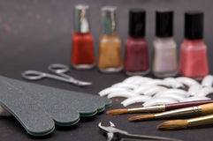 Set of nail care accessories closeup. Set of nail care accessories on dark background stock image