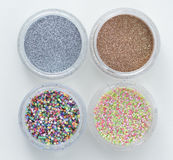 Set of nail glitter. With four small jars Royalty Free Stock Photos