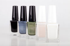 Set of nail polish bottles. Isolated on white royalty free stock image