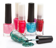 Set of nail polish bottles and spilled lacquer Royalty Free Stock Photos