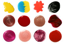 Set of nail polish and lip gloss samples. Isolated on white Stock Images