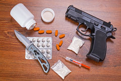 Set of narcotics and handgun Royalty Free Stock Photos