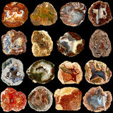 Set of natural agate rocks isolated on black background Royalty Free Stock Image